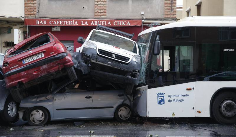 Out-of-control bus ploughs into parked cars as driver suffers heart attack